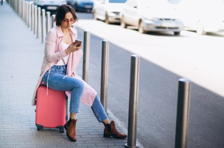 Woman with phone at airport